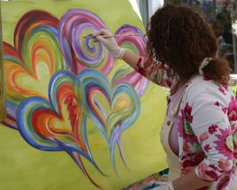 Debbie Marie Arambula painting a family of hearts