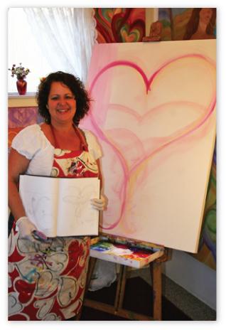 """Debbie Marie with the sketch & beginning of """"Believe"""" in her studio."""