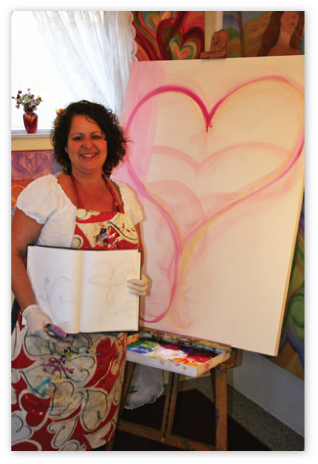 "Debbie Marie with the sketch & beginning of ""Believe"" in her studio."