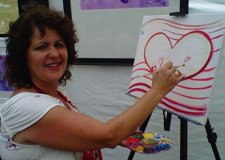 Debbie Arambula beginging Red, White and Blue painting on July 4th 2011