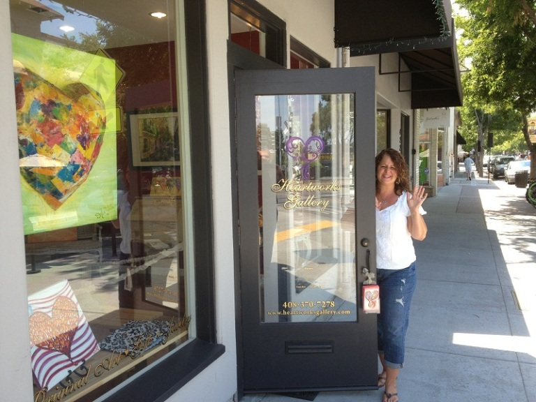Debbie Waiving Goodbye from her Heartworks Gallery in Downtown Campbell California