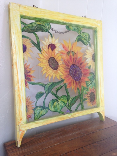 yellow sunflowers with green leafs painted on glass vintage window by debbie arambula painter of love